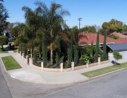 Photo of 1825 E Queensdale Street, Compton, CA 90221 (MLS # DW19038269)