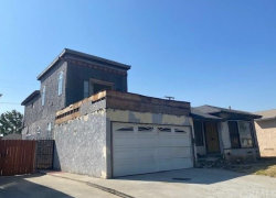 Photo of 1516 W 138th Street, Compton, CA 90222 (MLS # DW21002111)