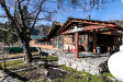 Photo of 1800 Call Of The Canyon Road, Lytle Creek, CA 92358 (MLS # IV19050593)