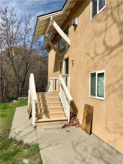 Photo of 496 Call Of The Canyon Road, Lytle Creek, CA 92358 (MLS # IV20043030)