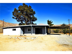 Photo of 49393 Park Avenue, Morongo Valley, CA 92256 (MLS # JT17269888)