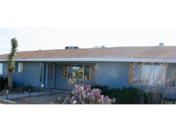Photo of 57175 Hillcrest Drive, Yucca Valley, CA 92284 (MLS # JT17271085)
