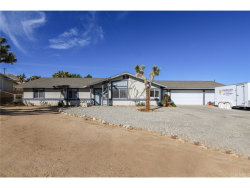Photo of 8436 Grand Avenue, Yucca Valley, CA 92284 (MLS # JT18248039)