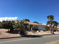 Photo of 9721 Clubhouse Boulevard, Desert Hot Springs, CA 92240 (MLS # JT19051948)