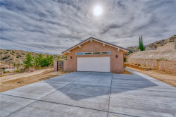 Photo of 54015 Pinon Drive, Yucca Valley, CA 92284 (MLS # JT20013577)
