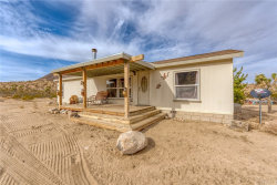 Photo of 55616 Pipes Canyon Road, Yucca Valley, CA 92284 (MLS # JT21006572)