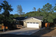 Photo of 18150 Bobcat Court, Hidden Valley Lake, CA 95467 (MLS # LC19154859)