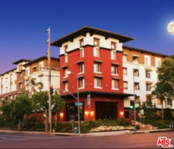 Photo of 6150 Canoga Avenue, Unit 319, Woodland Hills, CA 91367 (MLS # 19533646)