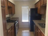 Photo of 10555 Turtlewood Court, Unit 2115, Houston, TX 77072 (MLS # 82059104)
