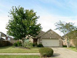 Photo of 6703 Lonesome Woods Trl, Humble, TX 77346 (MLS # 21233420)
