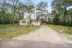 Photo of 1106 Columbia River Road, Conroe, TX 77316 (MLS # 42749047)