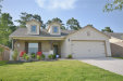 Photo of 1706 Wandering Hills Road, Conroe, TX 77304 (MLS # 67907022)