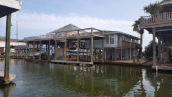Photo of 242 China Clipper Drive, Freeport, TX 77541 (MLS # 98684303)