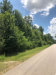 Photo of 3.8 CRIPPLE CREEK Drive, Pinehurst, TX 77362 (MLS # 74078025)