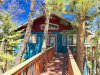 Photo of 1560 Tuolumne Road, Big Bear City, CA 92314 (MLS # 3171579)