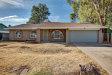 Photo of 5433 W Freeway Lane, Glendale, AZ 85302 (MLS # 5675828)