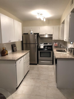 Photo of 1650 N 87th Terrace, Unit 7, Scottsdale, AZ 85257 (MLS # 5857415)