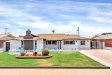 Photo of 8219 E Clarendon Avenue, Scottsdale, AZ 85251 (MLS # 5940227)