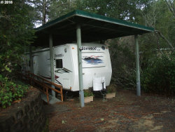Photo of 118 SAILOR LN, Florence, OR 97439 (MLS # 18192033)