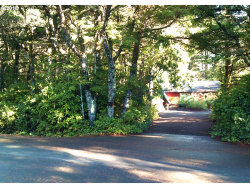 Photo of 88003 WOODLANDS DR, Florence, OR 97439 (MLS # 18274063)