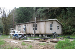 Photo of 63570 FAIRVIEW RD, Coquille, OR 97423 (MLS # 19132100)