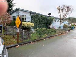 Photo of 100 RIVER BEND RD, SPACE , Unit 13, Reedsport, OR 97467 (MLS # 19249141)