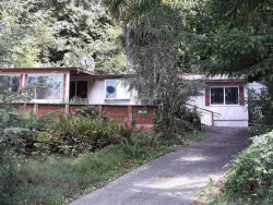 Photo of 89319 SUTTON LAKE DR, Florence, OR 97439 (MLS # 19472570)