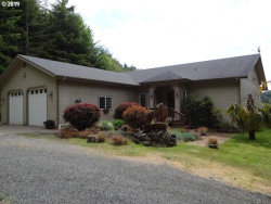Photo of 560 SCHOLFIELD RD, Reedsport, OR 97467 (MLS # 19513381)