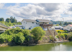 Photo of 753 W RIVERSIDE DR, Coquille, OR 97423 (MLS # 19631490)