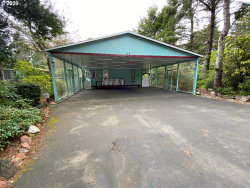 Photo of 1600 RHODODENDRON DR , Unit 116, Florence, OR 97439 (MLS # 20043226)