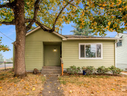 Photo of 11705 SE PINE ST, Portland, OR 97216 (MLS # 20449079)