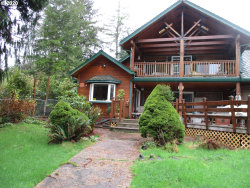 Photo of 88823 RHODODENDRON LN, Florence, OR 97439 (MLS # 20673827)