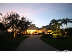 Photo of 213 Lansing Island Drive, Indian Harbour Beach, FL 32937 (MLS # 651283)