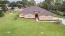 Photo of 7045 Hundred Acre Drive, Cocoa, FL 32927 (MLS # 796777)