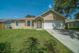 Photo of 2404 Wolf Creek Drive, Melbourne, FL 32935 (MLS # 816873)