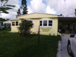 Photo of 409 Plover Drive, Barefoot Bay, FL 32976 (MLS # 817511)