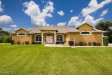 Photo of 7524 Egret Drive, Titusville, FL 32780 (MLS # 824399)