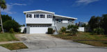 Photo of 910 Aida Circle, Indian Harbour Beach, FL 32937 (MLS # 828812)
