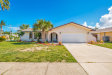 Photo of 1199 Bay Drive, Indian Harbour Beach, FL 32937 (MLS # 831126)