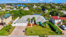 Photo of 21 Indian Village Trail, Cocoa Beach, FL 32931 (MLS # 832079)