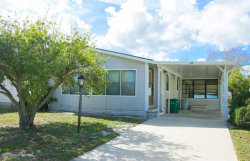 Photo of 715 Gladiolus Drive, Barefoot Bay, FL 32976 (MLS # 836677)