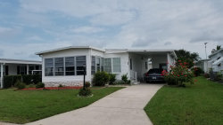Photo of 909 Frangi Pani Drive, Barefoot Bay, FL 32976 (MLS # 855960)