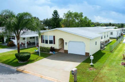 Photo of 840 Hawthorn Circle, Barefoot Bay, FL 32976 (MLS # 857739)