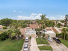Photo of 403 Hawthorne Court, Indian Harbour Beach, FL 32937 (MLS # 858048)