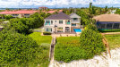 Photo of 3185 S Highway A1a, Melbourne Beach, FL 32951 (MLS # 863149)