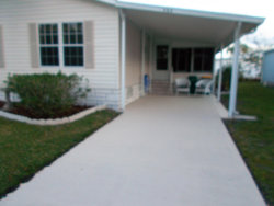 Photo of 906 Cashew Circle, Barefoot Bay, FL 32976 (MLS # 871221)