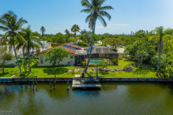Photo of 1 Sloop Drive, Cocoa Beach, FL 32931 (MLS # 876352)