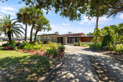 Photo of 710 Unity Drive, Indian Harbour Beach, FL 32937 (MLS # 878280)