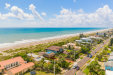 Photo of 945 S Atlantic Avenue, Cocoa Beach, FL 32931 (MLS # 880995)