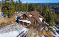 Photo of 320 Summit Road, Woodland Park, CO 80863 (MLS # 4589081)